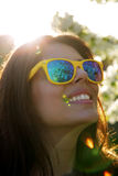 Smiling woman in fashionable sunglasses Royalty Free Stock Images