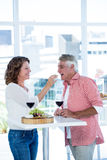 Smiling woman feeding food to man Royalty Free Stock Photography