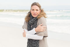 Smiling woman feeling the cold Royalty Free Stock Photography
