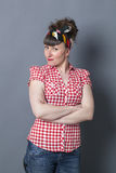 Smiling woman with fifties look posing and arms crossed Stock Image