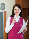 Smiling  woman with financial documents Stock Images