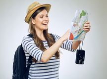 Smiling woman finding place on paper map. Royalty Free Stock Images