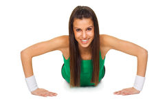 Smiling woman in fitness puhsup Royalty Free Stock Photo