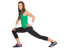 Smiling woman fitness stratching Stock Photography