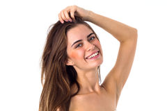 Smiling woman fixing her hair Royalty Free Stock Photos