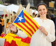 Smiling woman with  Flag of Catalonia Royalty Free Stock Images