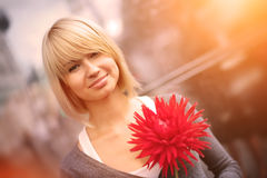 Smiling woman with flower Royalty Free Stock Photo
