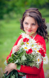 Smiling woman with flower Royalty Free Stock Images