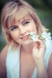 Smiling woman with flower Stock Image