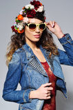 Smiling woman in flower crown wearing sunglasses Stock Images