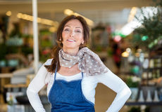 Smiling Woman In Flower Shop Royalty Free Stock Photo