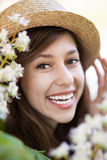Smiling woman with flowering tree Royalty Free Stock Photography