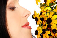 Smiling woman with flowers Stock Images