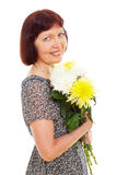 Smiling woman with flowers Royalty Free Stock Photography