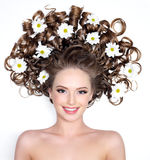 Smiling woman with flowers in hair royalty free stock photos
