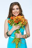Smiling woman with flowers. Isolated portrait of happy girl Royalty Free Stock Image