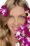 Smiling woman with flowers Royalty Free Stock Photos