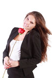 Smiling woman with flying hair holds red rose Royalty Free Stock Photos