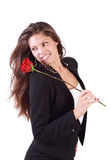 Smiling woman with flying hair holds rose Stock Photography