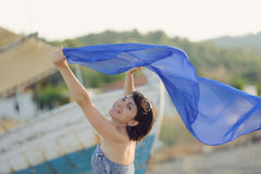 Smiling Woman with Flying Scarf Stock Image