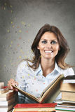 Smiling woman among flying words Royalty Free Stock Image