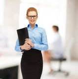 Smiling woman with folder Royalty Free Stock Photos