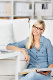 Smiling woman with folder and notebook Royalty Free Stock Image