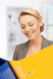 Smiling woman with folders Stock Photo