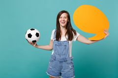 Smiling woman football fan cheer up support team with soccer ball, empty blank yellow Say cloud, speech bubble isolated. On blue turquoise background. People stock images
