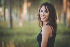 Smiling woman. In the forest Royalty Free Stock Photo