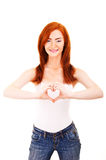 Smiling woman forming a heart with her hands Royalty Free Stock Photography