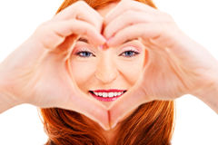 Smiling woman forming a heart with her hands Royalty Free Stock Images