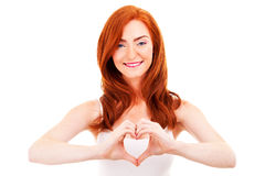 Smiling woman forming a heart with her hands Royalty Free Stock Image