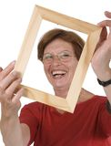 Smiling woman and frame Stock Photography