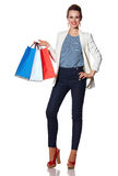 Smiling woman with French flag colours shopping bags Royalty Free Stock Photo