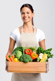 Smiling woman with fresh produce Stock Images