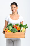 Smiling woman with fresh produce Royalty Free Stock Photography
