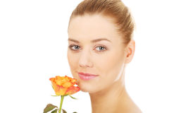 Smiling woman with fresh rose. Stock Photo