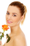 Smiling woman with fresh rose. Royalty Free Stock Photos