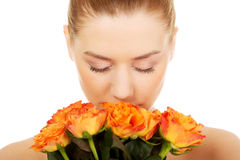 Smiling woman with fresh roses. Stock Photo
