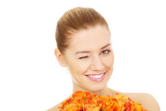 Smiling woman with fresh roses. Royalty Free Stock Photo