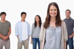 Smiling woman with friends standing behind her Stock Photos