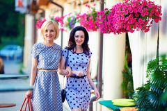 Smiling woman friends walking the summer city Royalty Free Stock Photos
