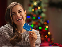 Smiling woman in front of Christmas tree Stock Photo