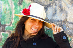 Smiling woman in front of a graffiti wall Royalty Free Stock Photo