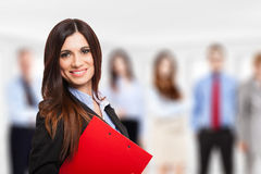 Smiling woman in front of a group of people Royalty Free Stock Images