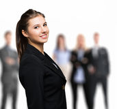 Smiling woman in front of a group of people Royalty Free Stock Image