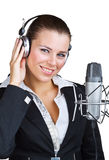 Smiling woman in front of a microphone headset Stock Photo