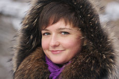 Smiling woman in frosty day Royalty Free Stock Photography