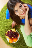 Smiling woman with fruit. Stock Photography